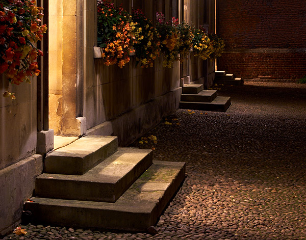 flowers over steps in First Court within St. John's College at Cambridge University in England