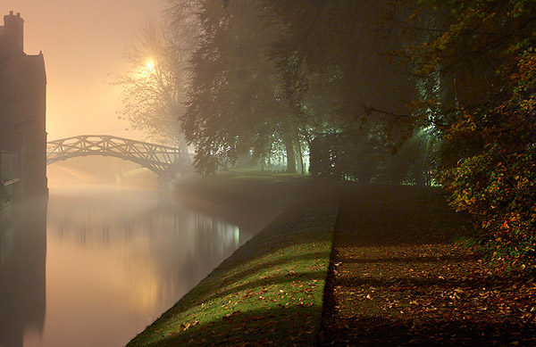 Mathematical Bridge in the fog from Queens' College at Cambridge University in England