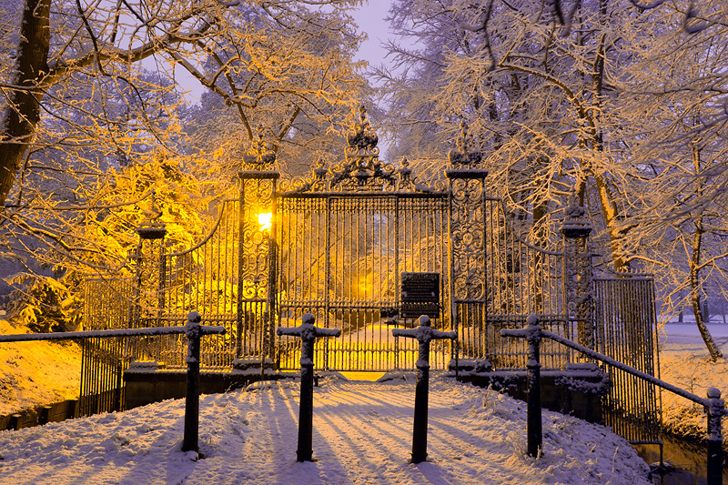 snow-covered gate leading into St. John's College at Cambridge University in England