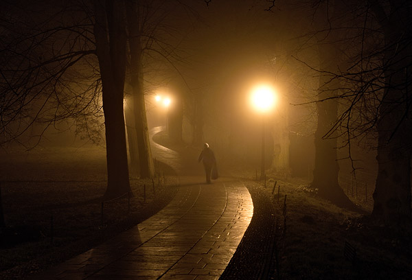 dark foggy path winding out of King's College at Cambridge University in England