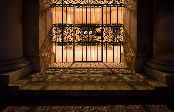 gate at Nevile's Court within Trinity College at Cambridge University in England