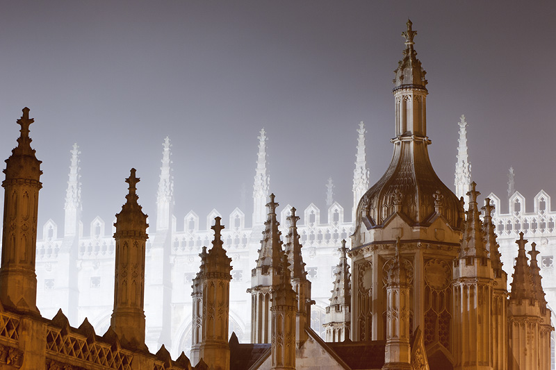 back-lit foggy spires from outside King's College at Cambridge University in England