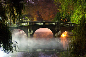 clare bridge at night in the fog - cambridge, england