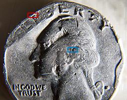 снимок монеты крупным планом при увеличении 0.3X